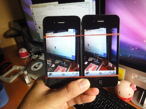 MacGyver'ed dual iPhones with rubber-bands